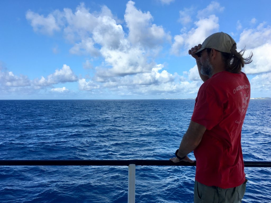 Michael Gonsior overlooks the vast Atlantic Ocean as our expedition finally begins. There are scattered clouds in the sky.